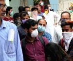 COVID-19 pandemic: Patients wearing masks outside Beleghata ID hospital