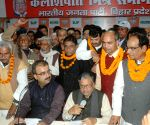 Mangal Pandey, Sushil Kumar Modi during a programme organised to induct new members