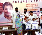 Bihar Youth Congress president Rajesh Sinha and Gungan Patel, distribute ration for poor people on the Birth anniversary of Rahul Gandhi in Patna.