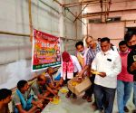 BJP Sports Cell today distributed masks and food among the needy people of slum settlement near Jain Dharamshala, Mithapur in Patna