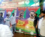 Chirag Paswan supporters and Lok Janshakti Party supporters putting black ink on the poster of rebel MPs at the Party office in Patna.
