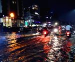 Commuters wade through the waterlogged Gandhi Maidan Road after heavy rain, during the monsoon season, in Patna