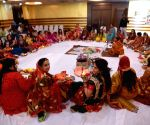 Married women perform rituals on the occasion of Karva Chauth in Patna