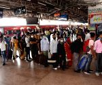 Migrants arriving from Maharashtra wait in a queue for COVID-19 testing at Patna railway station in Patna