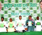 RJD releases party manifesto, promises reservation