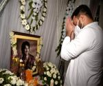 RJD leader Tejashwi Yadav paying tributes to late actor Sushant Singh Rajput on his first death anniversary, in Patna.