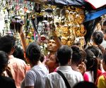 People are busy shopping at the market ahead of Eid al-Fitr festival in Kolkata.
