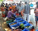 People buying vegetables at Sufal Bangla during lockdown