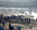 People busy cleaning sea beach