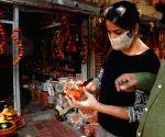 People buy earthen lamps ahead of Diwali celebrations
