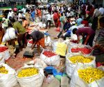 People buying flowers near KR Market during lockdown in the wake of the 2nd wave  of COVID-19, in Bengaluru