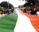 People carry 90 feet long Tricolour during rally on 73rd Independence Day