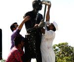Mahatma Gandhi statue being cleaned on the eve of Gandhi Jayanti