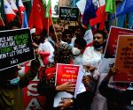 Kolkata : People protest and demonstrate against Assam Government over violence in an eviction drive at Assam .