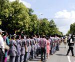 People gather at 10 Rajaji Marg to pay tribute to Kalam