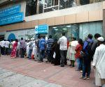 : (211116) Bengaluru: People queue at bank