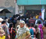 People queue outside bank