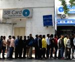 People queue outside bank