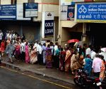 People queue up outside a bank