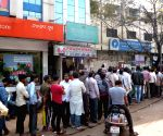 People queue at bank