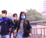 People wear face masks amid surging Covid-19 cases and deaths in the national capital