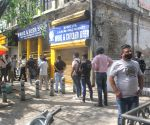 People stand in a que for buying wine at a wine shop Gole market CP after Delhi CM Arvind Kejriwal announce one week Lockdown in new Delhi