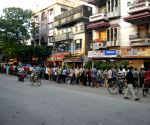 People stand in a queue at a liquor store, due to lockdown started from tomorrow during coronavirus pandemic in Kolkata