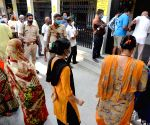 Kolkata : People stand in a queue at a polling station to cast their vote during the 6th phase of West Bengal's State Assembly elections at Barrackpore constituency in North 24 Parganas on April 22, 2021