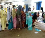 Kolkata : People stand in a queue at a polling station to cast their vote during the 6th phase of West Bengal's State Assembly elections