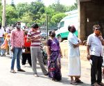 People standing in a queue at Primary Health Centre during COVID-19 vaccination drive in the wake of the 2nd wave of COVID-19 in Bengaluru in Bengaluru