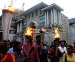 Torch rally taken out over political violence and disrupted health services in West Bengal