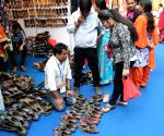 People visit stalls at the India International Trade Fair