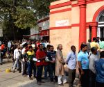 People queue up outside New Delhi GPO post office to exchange Rs 1000, 500 notes