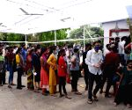 Peoples ignoring social distance stand in a queue to register their names for COVID-19 tests, amid a countrywide spike in coronavirus cases, at a government health center, in Patna