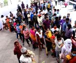 Peoples ignoring social distance stand in a queue to register their names for COVID-19 tests, amid a countrywide spike in coronavirus cases, at New Gardiner Road government health center, in Patna