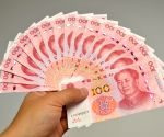 Chinese yuan edges lower against US dollar