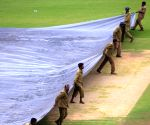 Pitch at the M. Chinnaswamy Stadium covered during rains