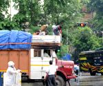 Kolkata : Police are getting down the worker who climbed on the lorry illegally in the rain in Kolkata