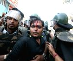 Protesters get violent during a protest to mark the 21st anniversary of demolition of Babri Masjid