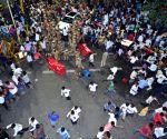 Karunanidhi in ICU, police charge batons outside hospital