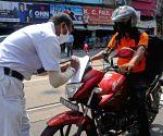 Kolkata : Police personnel checking vehicles at Naka Point during the lockdown on Coronavirus pandemic in Kolkata