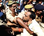 Police personnel stop Congress party workers during a protest over lodging of  FIR against senior party leader Pramod Tiwari and legislature party leader Aradhana Mishra