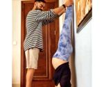 Pregnant Anushka Sharma performs Shirshasana with Virat's support