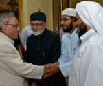 President Pranab Mukherjee being greeted by Muslims
