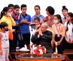 President Mukherjee meets students/children from various school/organisations on Children's Day