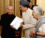President Mukherjee receives the first copy of 'Garuda Purana
