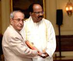 President Mukherjee releases Veerappa Moily's book