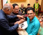 President Kovind administers polio drops to a child