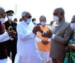 : Patna:President Ram Nath Kovind being greeted by Bihar Chief Minister Nitish Kumar and Governor Fagu Chauhan during his departure at Jai Prakash Narayan Airport,