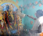 Priest performing rituals on the morning of Dasami day during Durga Puja festival
